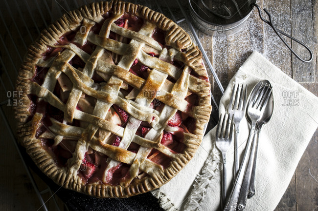 Homemade strawberry apple pie served on a wood table