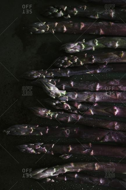 Purple asparagus on a baking sheet