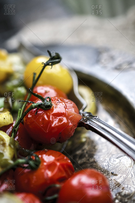 Close up of grilled tomatoes on a platter