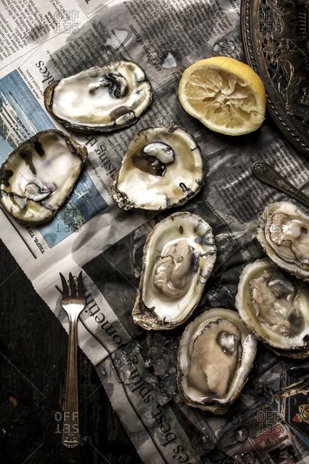 Oysters served on a newspaper