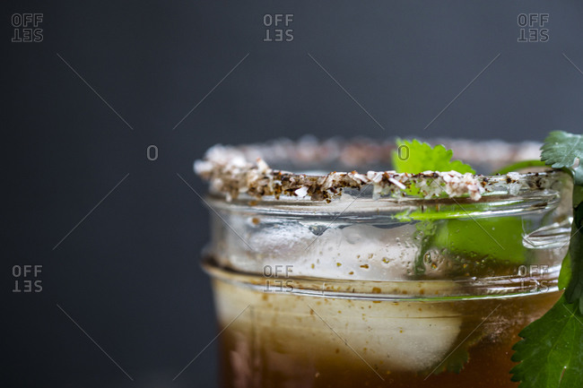 Spicy michelada served in a salt rimmed glass