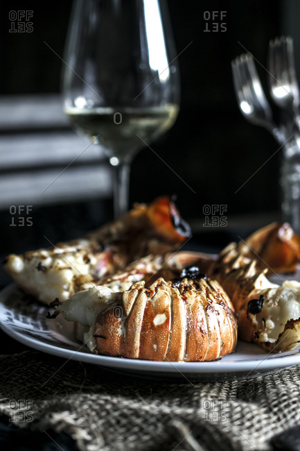 Grilled lobster tails served with white wine