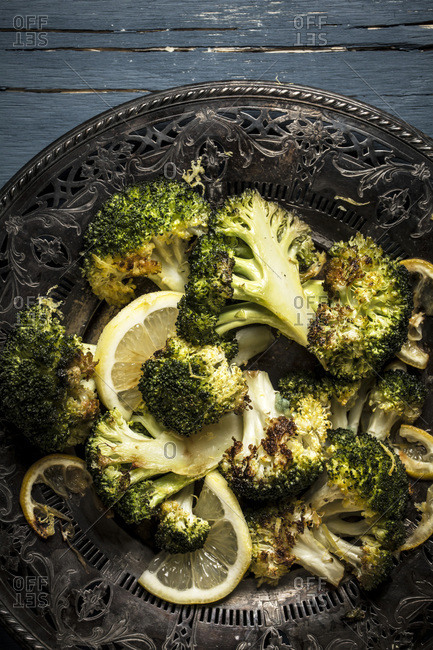 Roasted broccoli florets and lemon slices