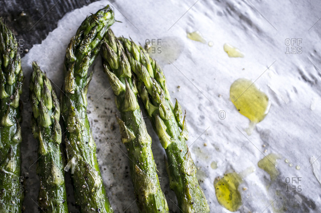 Roasted asparagus drizzled with olive oil