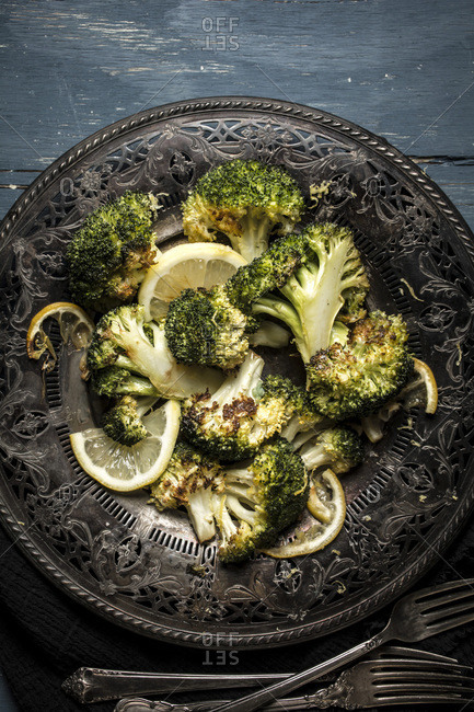 Roasted broccoli served on an antique plate
