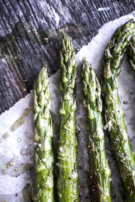 Roasted green asparagus on a wooden table