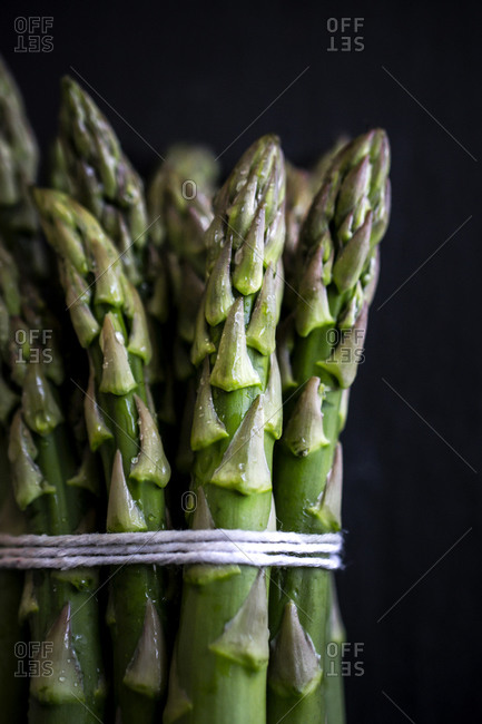 Water droplets on a bunch of fresh asparagus