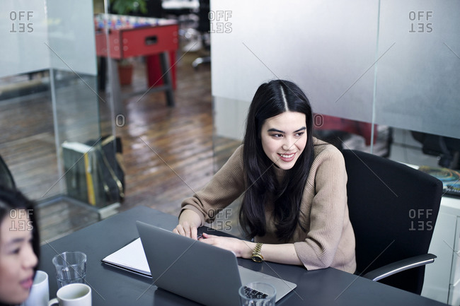 Woman with open laptop during meeting