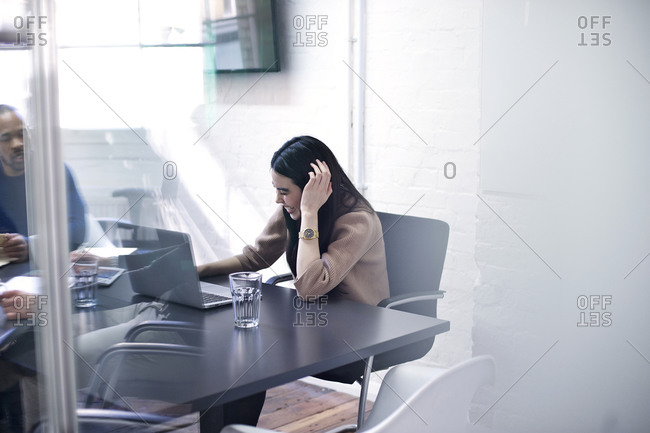 Woman smiling while listening during meeting