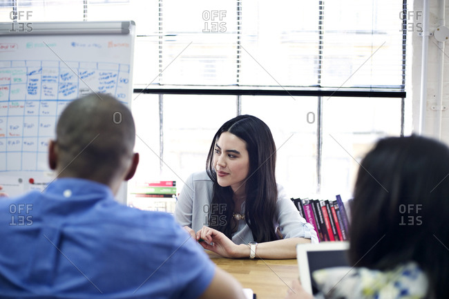 Woman leading presentation during meeting