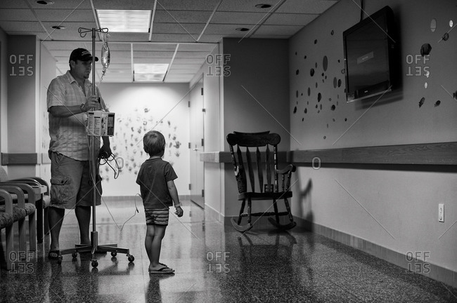 Father walking with his son in a hospital