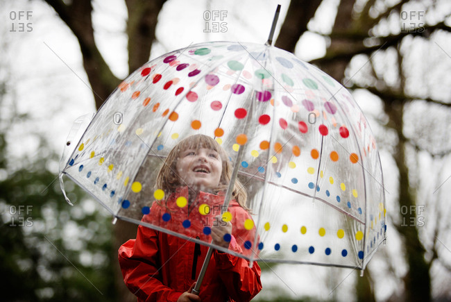 A little girl in a bucket umbrella