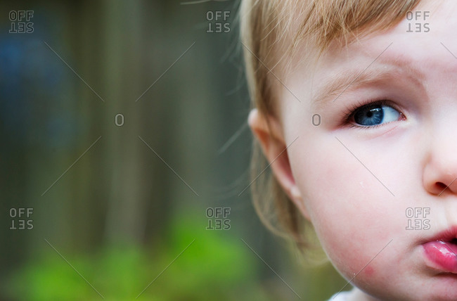 A toddler looks to the side