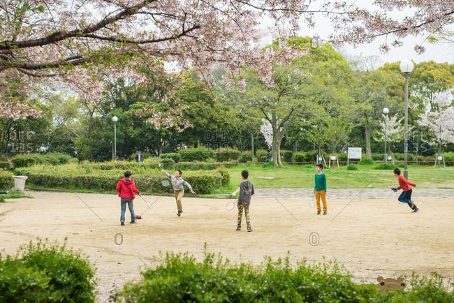 Chishima Province, Japan - April 6, 2015: Boys play badminton in Chishima Province in Japan