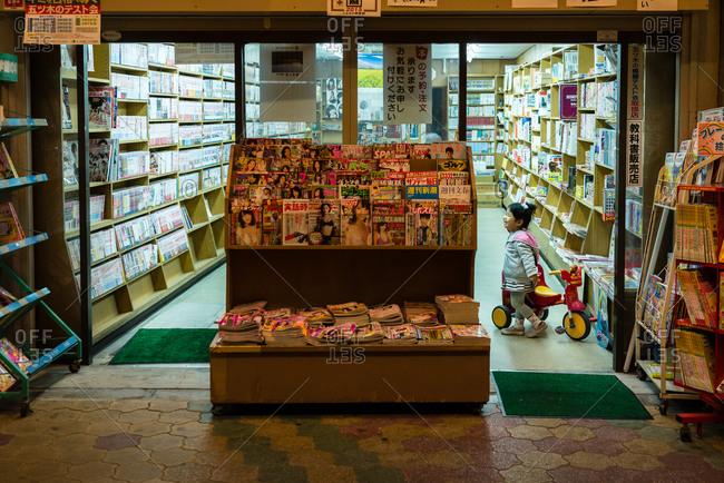 Osaka, Japan - April 7, 2015: A little girl in a bookstore in Tengachaya, Osaka, Japan