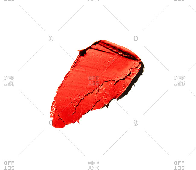 Deep red lipstick smear on white background