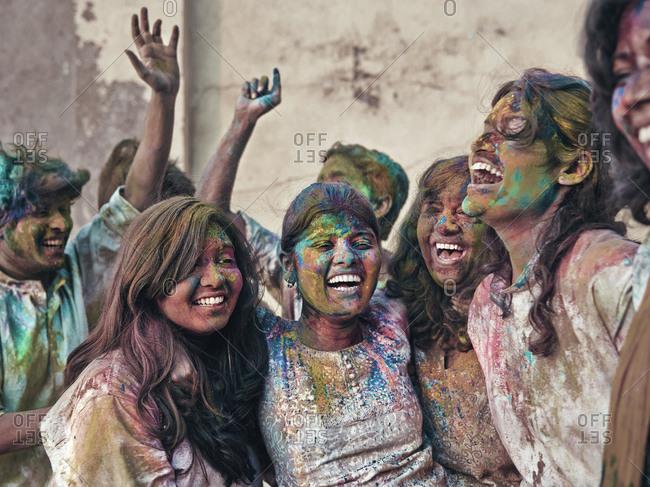 Mumbai, India - February 13, 2013: Group of students celebrating Holi festival in India