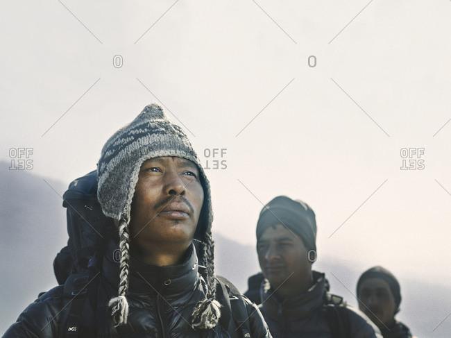 Pokhara, Nepal - February 13, 2013: Sherpas trekking in the foot hills of Pokhara, Nepal