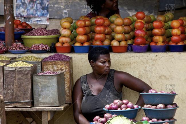 Kasese, Uganda - January 17, 2010: Lady selling produce on roadside market in Kasese, Uganda