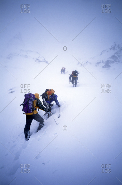 Ice climbers climbing frozen waterfall