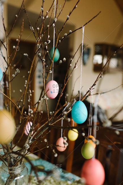 Easter decorations with colorful eggs on catkin twigs