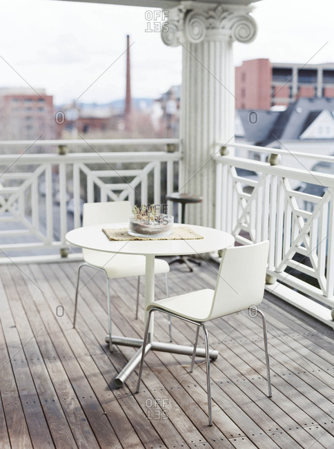 White table with chairs on a balcony