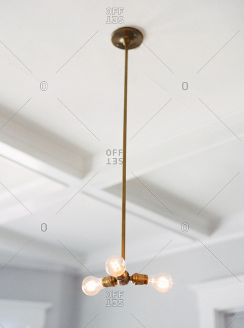 Light fixture hanging from a ceiling