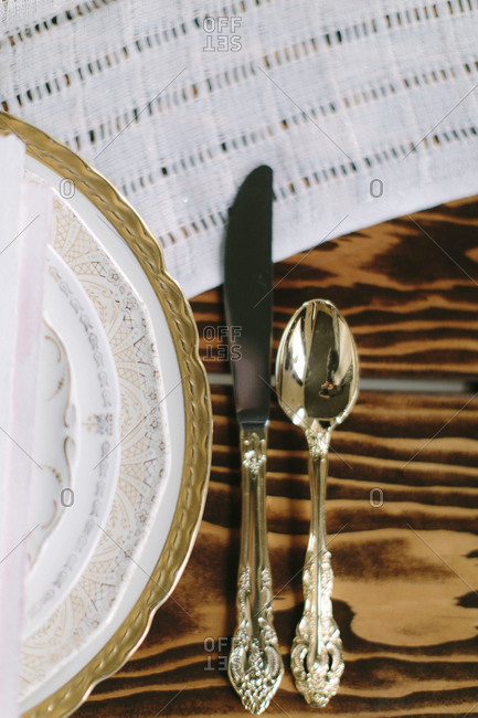 Gold plated cutlery by gold rimmed plates