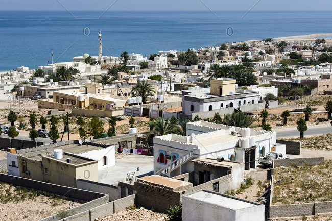 The homes and community compounds of Tiwi Town along the coast of the Gulf of Oman