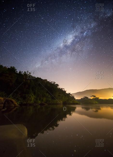 Itamambuca beach at night with the Milky Way visible, Ubatuba, Brazil