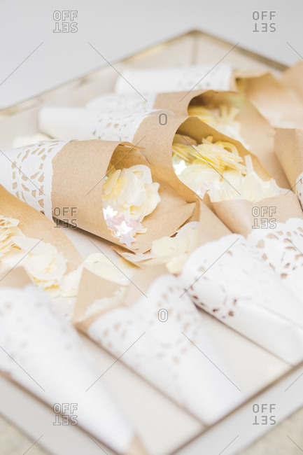 Party favors wrapped in paper doilies for wedding