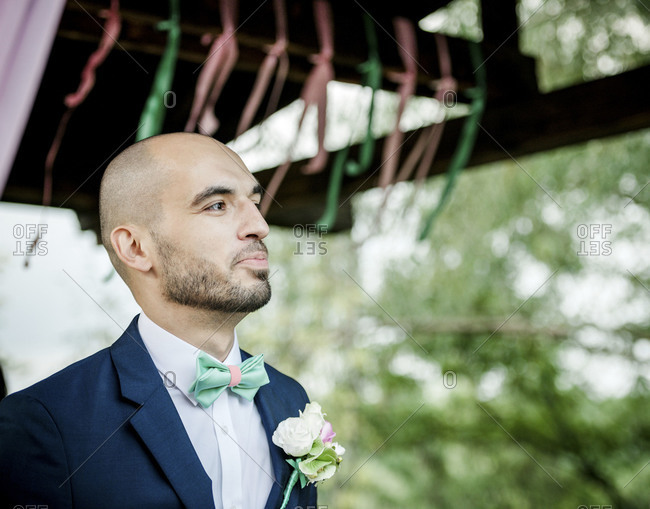 A groom waits for his bride to arrive at a wedding ceremony
