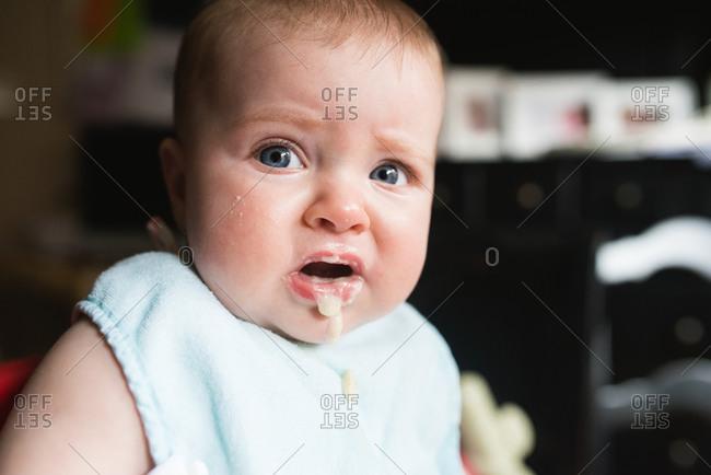 Portrait of infant drooling after eating