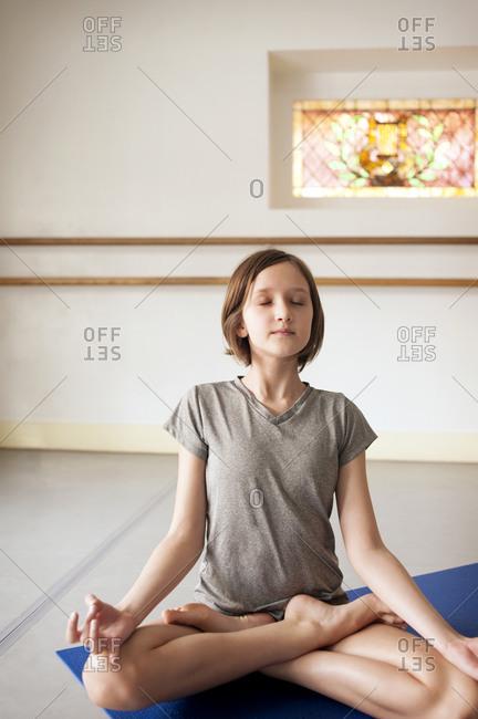 Young yogi seated in lotus pose
