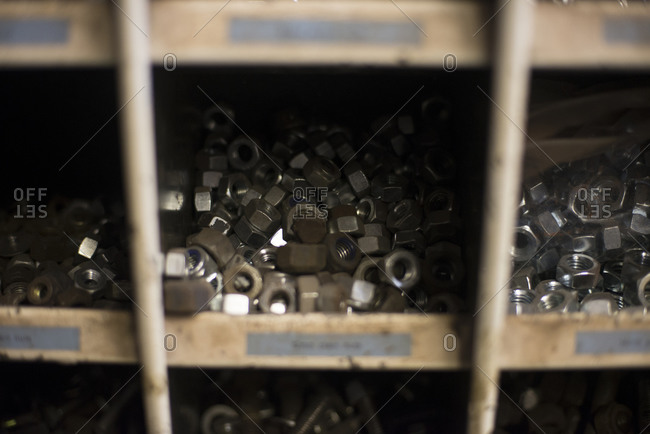 Metal nuts arranged by size on shelves