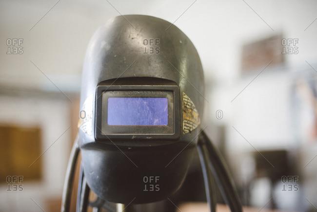 Welder's helmet in workshop