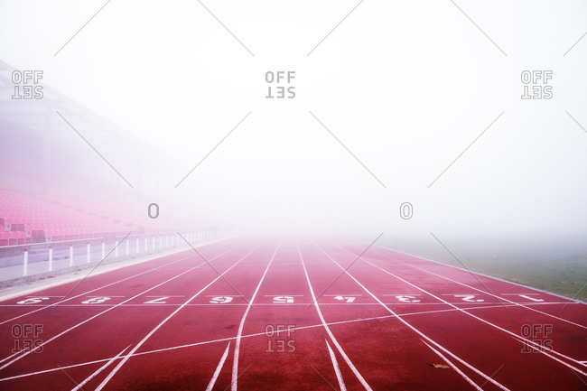 Running track obscured by fog