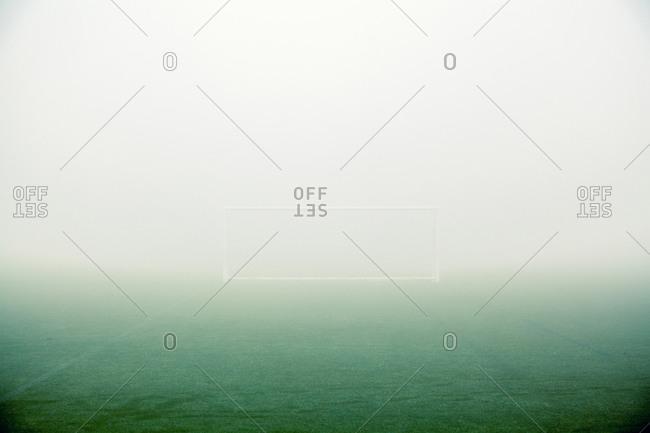 Soccer goal in foggy field