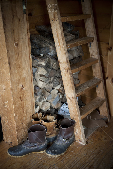Boots at the base of a rustic ladder
