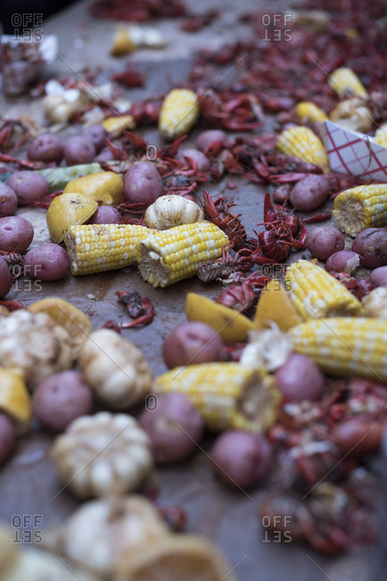Boiled crayfish with potatoes, corn and garlic