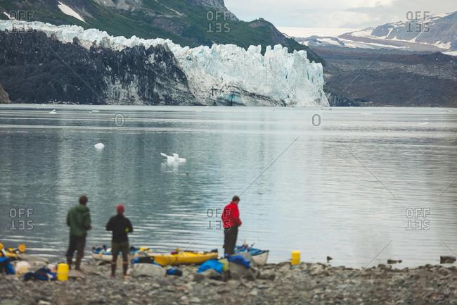 Sea kayakers enjoying view of glacier, Alaska