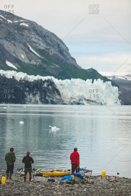 Sea kayakers enjoying view of glacier in Alaska