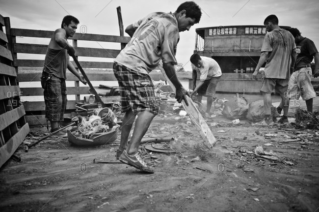 July 15, 2012: Men cleaning up garbage in Peru