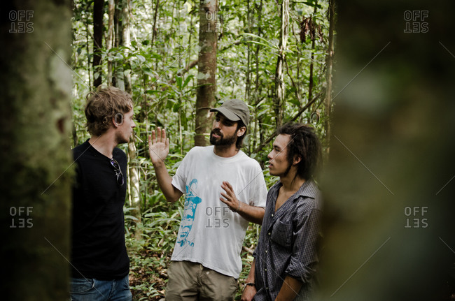 July 26, 2012: Three humanitarian aid workers in Amazon jungle having conversation