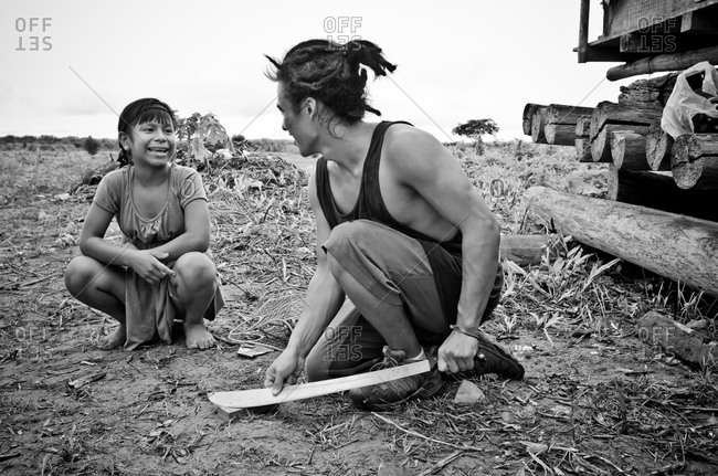 July 31, 2012: Young man talking to woman in field in Peru