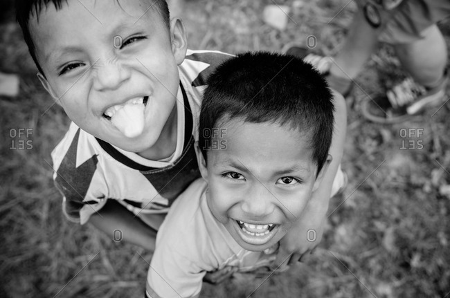 July 29, 2012: Two young boys in Peru smiling and hugging