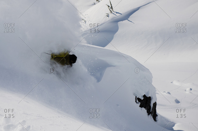 Snowboarder tearing up deep snow in Shames Mountains, BC, Canada