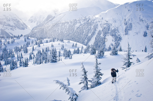 Person hiking in snow in Shame Mountains, British Columbia