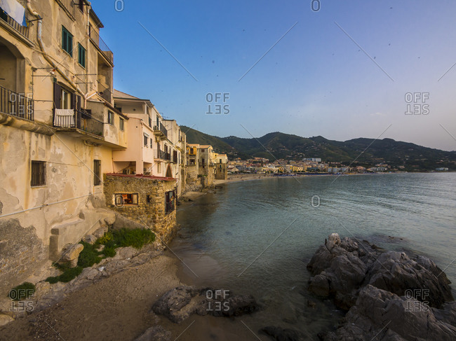 Cefalu, Sicily, Italy - June 24, 2014: View to the bay with medieval houses at evening twilight, Cefalu, Sicily