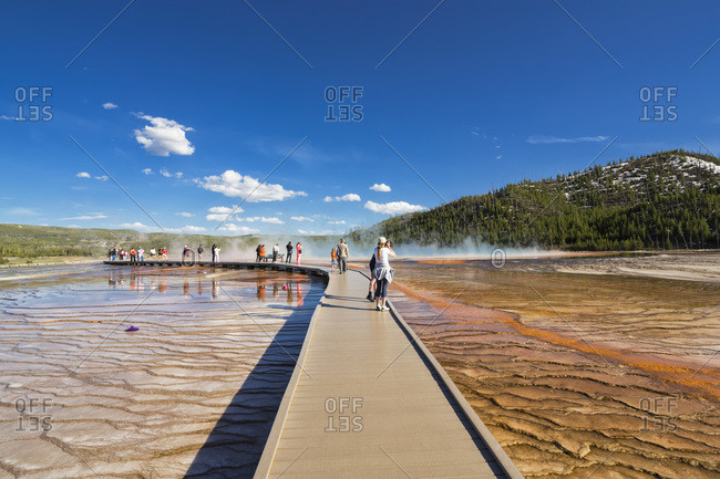 Tourists on footbridge before Grand Prismatic Spring, Yellowstone National Park